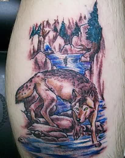 Wolf Walks Along A Mountain River Tattoo