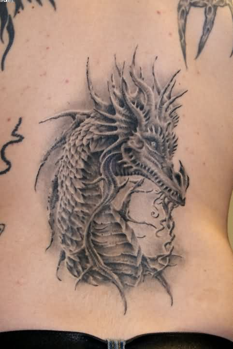 A Photo Realistic Tattoo Of A Western Dragon