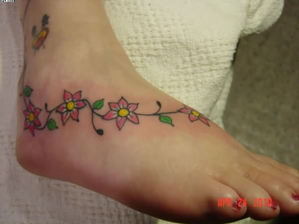 Beautiful Vines Flower Tattoo On Right Foot