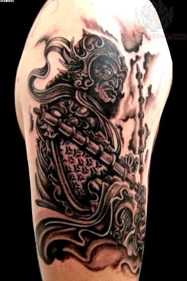 Black And Grey Ink Samurai Warrior Tattoo On Biceps