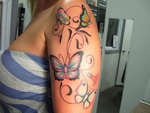 Colorful Butterflies And Vine Tattoos On Upper Arm