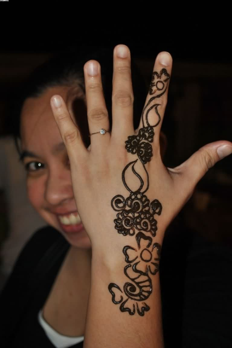 Girl Showing Henna Vine Tattoo On Hand