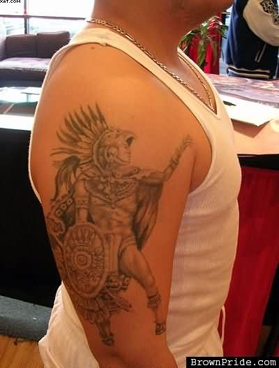 Grey Ink Aztec Warrior Tattoo For Biceps