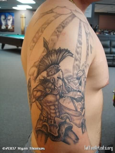 Grey Ink Spartan Warrior Tattoo On Biceps