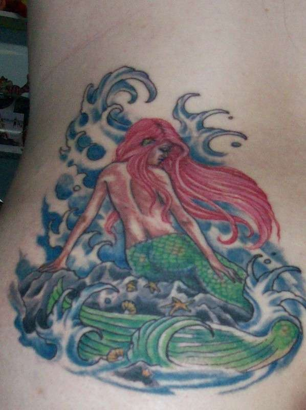 Mermaid And Blue Waves Tattoos On Waist