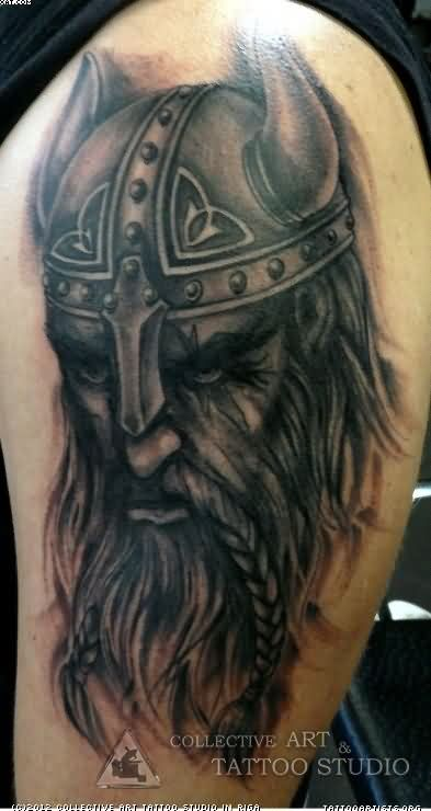 Realistic Viking Warrior Wearing Helmet Tattoo On Biceps