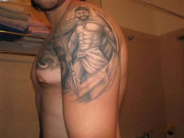 Spartan Warrior Tattoo With Grey Ink On Shoulder