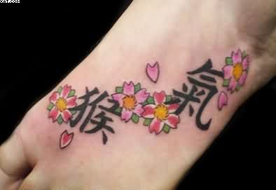 Western Kanji And Flowers Tattoos On Foot