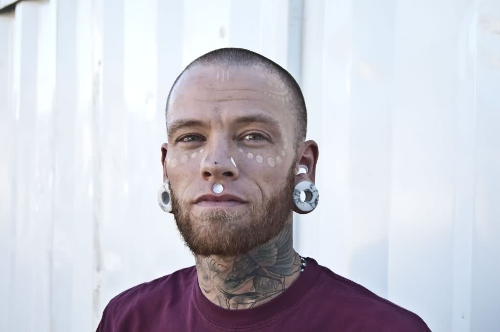 White Ink Tattooed Face