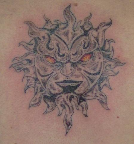An Evil Sun Tattoo With Grey Ink