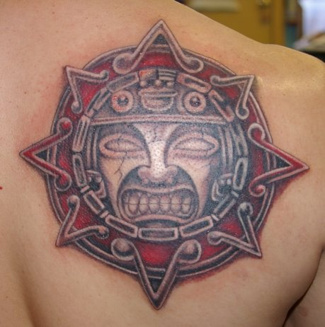 Angry Mayan Sun Tattoo On Right Back Shoulder