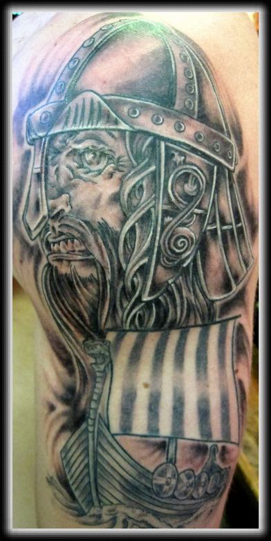 Angry Viking And Ship Tattoos