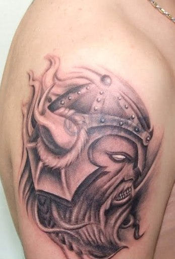 Angry Viking Tattoo On Biceps