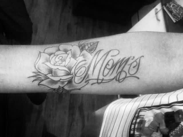 Black And White Mom's Rose Tattoo On Arm