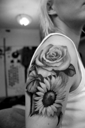 Black And White Rose And Sunflower Tattoos On Biceps