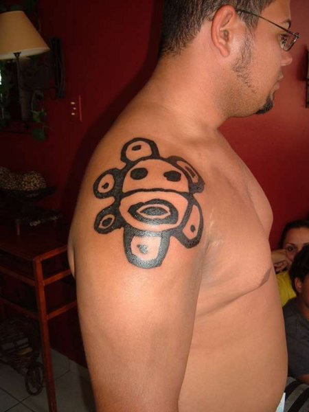 Black Ink Taino Sun Tattoo On Right Shoulder