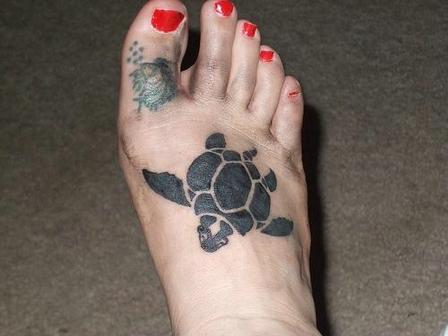 Black Ink Turtle Tattoo On Foot For Women