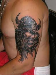 Black Ink Viking Head Tattoo On Muscles