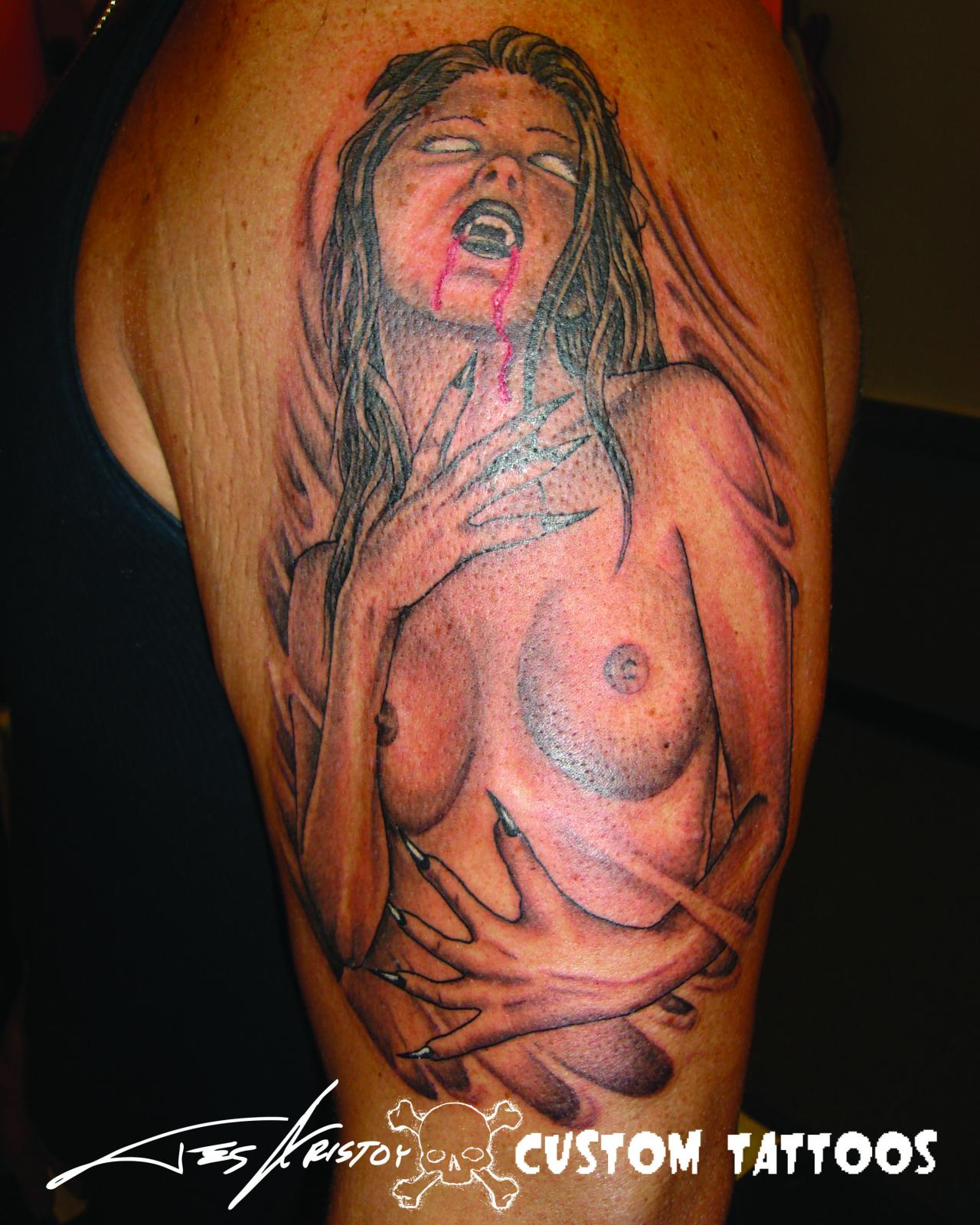Bleeding Vampire Girl Tattoo On Upper Arm