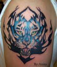 Blue Tiger Tribal Tattoo On Biceps