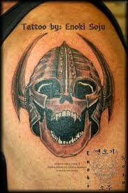 Brown Ink Viking Warrior Skull Tattoo On Biceps