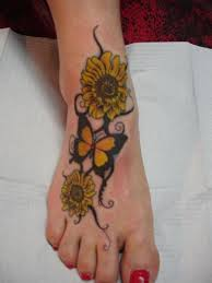 Butterfly And Sunflower Tattoos On Right Foot