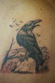 Crow On Tree Branch Tattoo