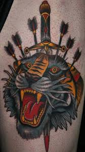 Dagger Through Tiger Head Tattoos
