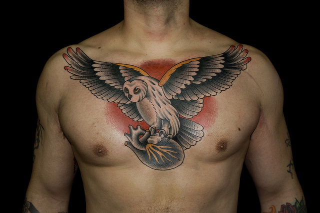 Fantastic Traditional Chest Piece Tattoo For Men