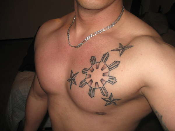 Filipino Sun And Stars Tattoos On Chest