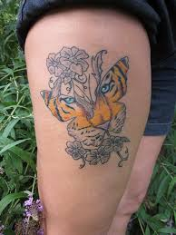 Flowers And Tiger Butterfly Tattoos On Thigh