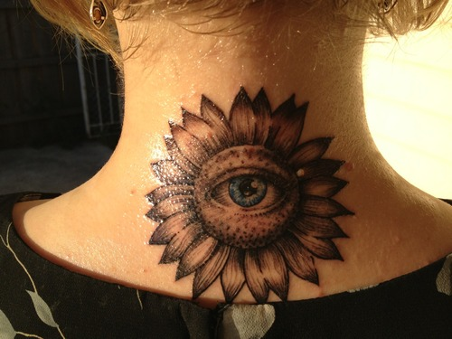 Glowing Eye Sunflower Tattoo For Back Neck