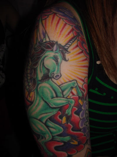 Green Ink Unicorn Tattoo On Right Sleeve