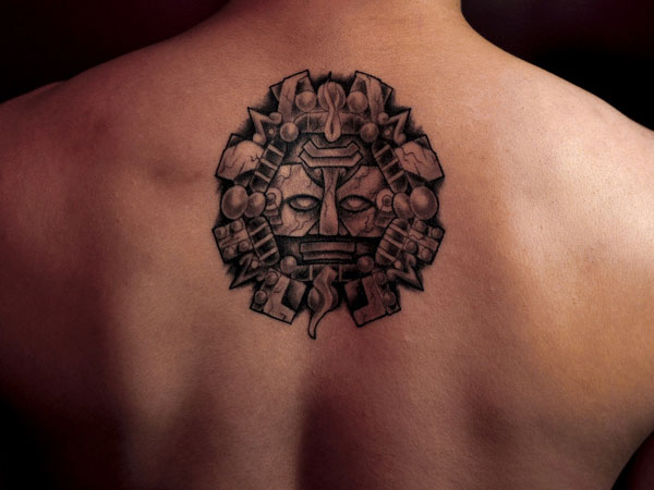 Grey Ink Aztec Sun Tattoo For Upper Back