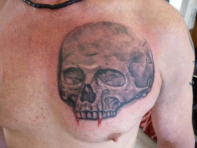 Grey Ink Vampire Skull Tattoo On Chest For Men