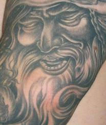 Grey Ink Viking Face Tattoo