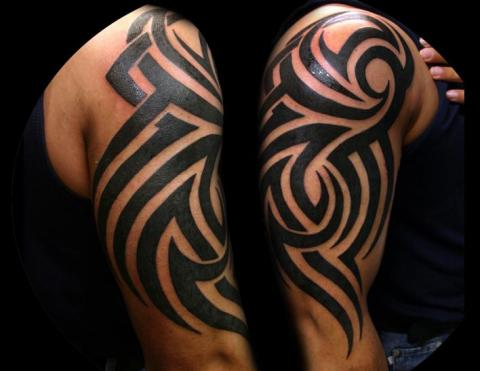 Half Sleeve Black Ink Tribal Tattoos For Guys