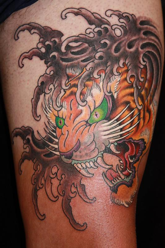 Japanese Waves And Tiger Tattoos