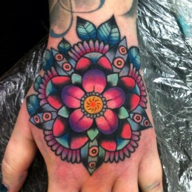 Lovely Traditional Mandala Flower Tattoo On The Hand