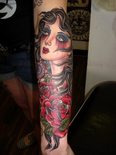 Lovely Traditional Woman And Roses Tattoos On Arm
