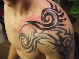 Mind Blowing Tribal Tattoo On Shoulder
