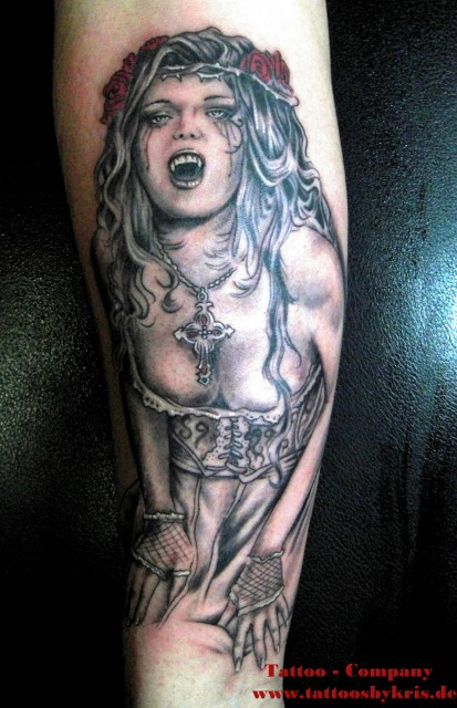 Miss Vampire Tattoo On Lower Arm