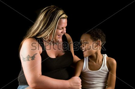 Mother And Seven Year Old Son Enjoy A Laugh Working Class Single Mom With Tattoos And Mixed Race
