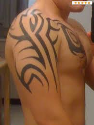 Nice Black Ink Tribal Tattoo On Chest And Arm