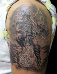 Old Viking Warrior With Thor Hammer Tattoo On Shoulder