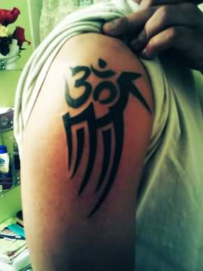 Om Symbol & Tribal Tattoos On Shoulder