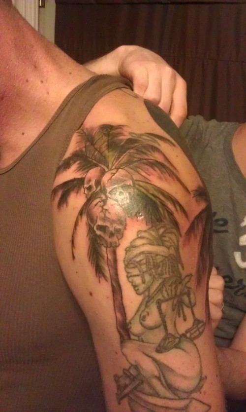 Palm Tree Skulls And Justice Lady Tattoos On Shoulder