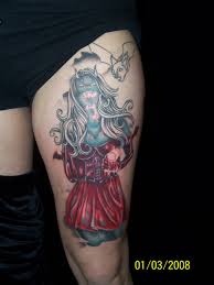Red Dressed Vampire Girl Tattoo On Thigh