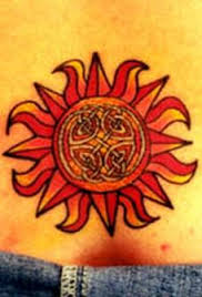 Red Ink Celtic Sun Tattoo On Waist