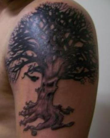 Round Shape Tree Tattoo On Shoulder